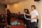 Colombian teenagers somehow all know how to make balloon stars.